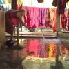Photo 19 : Ein Mönch säubert im Kloster in Mandalay mit Wasser den Waschplatz nach der Kleiderwäsche, die zum Trocknen hängt.Burma_Myanamar, 2012 © Werner Mansholt